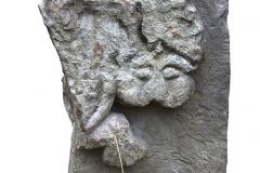 Рис. 1. Фрагмент каменного блока с рельефным изображением сцены терзания льва грифоном